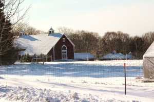 Snow on fields and barn