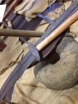 Scythe, anvil and hammer