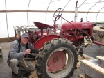 Bill fixing Freddy (our Cub tractor named for Frederick Law Olmsted:-)