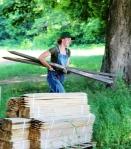 Sarah, hauling tomato stakes